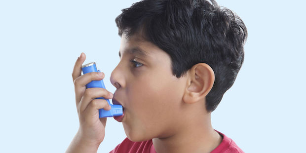 landscape-1445641861-1442998682-boy-using-asthma-inhaler